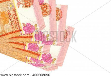 100 Sri Lankan Rupees Bills Lies In Small Bunch Or Pack Isolated On White. Mockup With Copy Space. B