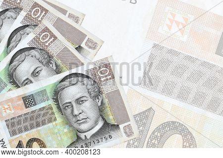 10 Croatian Kuna Bills Lies In Stack On Background Of Big Semi-transparent Banknote. Abstract Busine