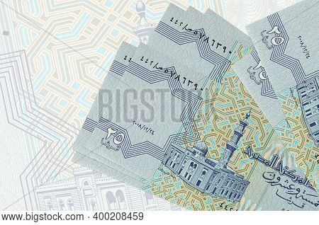 25 Egyptian Piastres Bills Lies In Stack On Background Of Big Semi-transparent Banknote. Abstract Pr