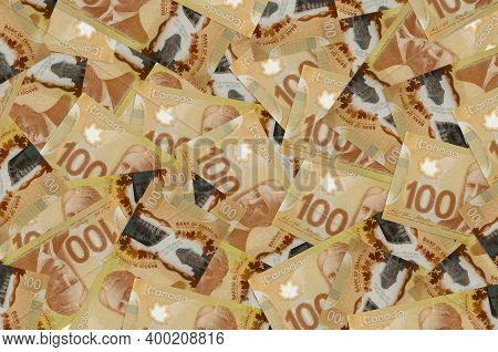 100 Canadian Dollars Bills Lies In Big Pile. Rich Life Conceptual Background