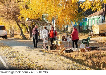 Saratov, Russia - 10/17/2020: Roadside Street Trade, Sale Of Homemade Food, People In The Village St