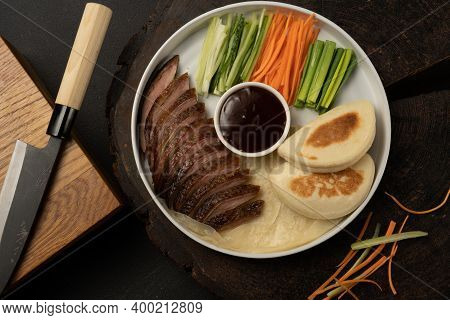 Peking Duck With Fresh Bao Bun. Traditional Chinese Dish Of Poultry And Vegetables Fillet With Teriy
