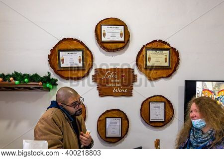 Bethlehem, Israel, December 09, 2020 : Winery Manager Communicates With Visitors In The Store Of The