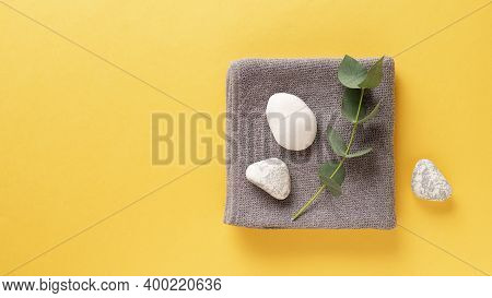 Trendy Colors Of The Year 2021. Illuminating Yellow And Ultimate Gray. Spa Background With Towel, Eu