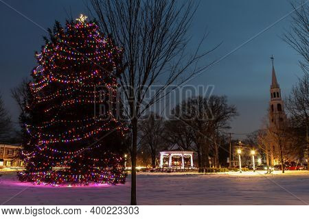 NORWALK, CT, DECEMBER 19, 2020: Christmas tree near Gazebo On The Green with First Congregational Church between Park Street and East avenue.