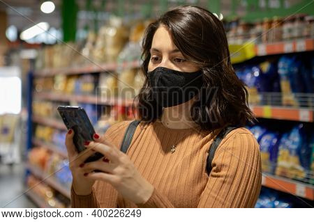 Woman Portrait At Grocery Store With Mask With Phone