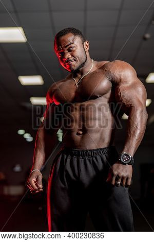 Athletic African American Man With A Bare Torso Posing And Shows His Muscles. Bodybuilding, Posing,