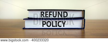 Refund Policy Symbol. Books With Words 'refund Policy' On Beautiful Wooden Table. White Background.