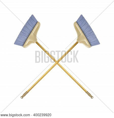 Cleaning Equipment - Two Crossed Brooms With Wooden Handle Isolated White Background