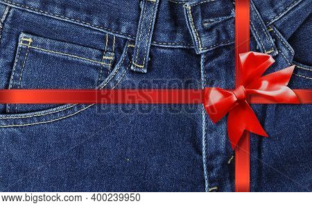 Clothes, Shoes And Accessories - Front View Closeup Fragment Blue Jeans Gift Tied Red Bow