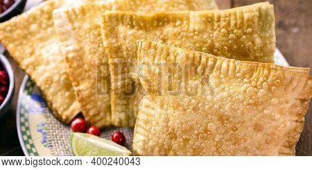 Brazilian Pastry, Traditional Pasta Called Meat Pastry On A Bar Table, With Lemon And Pepper, Typica