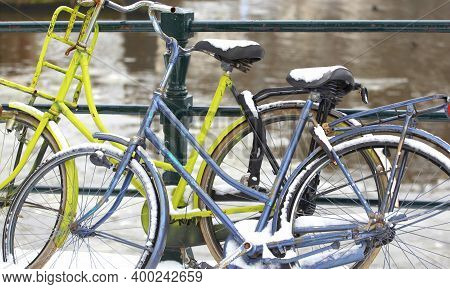 Bikes Parked In Winter Snow In Amsterdam, Netherlands.