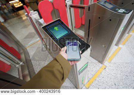 Shanghai, China - December 25, 2019. Nfc Payment In Shanghai Metro. Hand Mobile Pay Subway Gate Entr