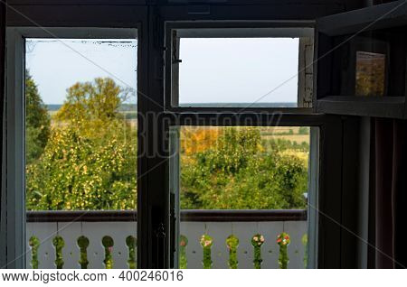 View On An Apple Orchard Through An Old Window, Focus On The Window Frame, Unfocused Landscape
