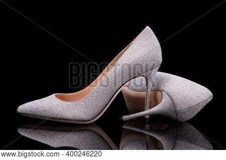Silver Heels. A Pair Of Beautiful Glitter Shoes. Pumps. Silvery Women Shoes. High-heeled Shoes.