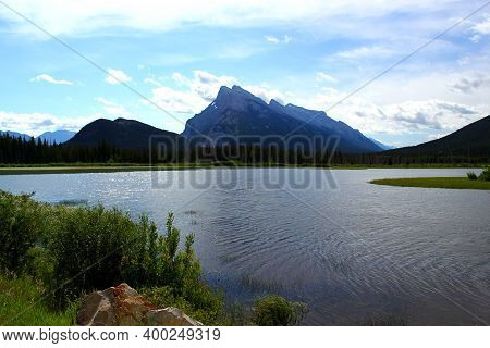 The Distinctive Mount Rundle And Vermillion Lake In The Canadian Rockies Near Banff In Alberta, Cana