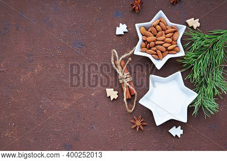 Ingredients For Cooking Candied Almonds On A Brown Concrete Background. Christmas Sweets Concept. Sw