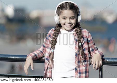 Enjoying Her Favorite Music. Little Girl Wearing Stereo Headphones. Little Girl Listening To Music.