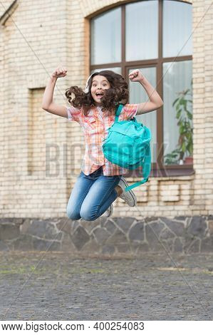 Happy Energetic Kid Jump With School Bag In Casual Style In Schoolyard, Holidays.