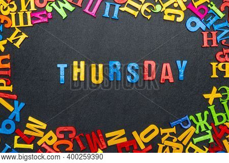 Thursday Word Made Of Bright Color Letters On Black Background.