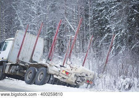A Logging Truck On Ice Went Into A Ditch. Accident On The Road In Winter.