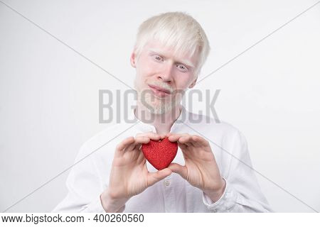 Albinism Albino Man In Studio Dressed T-shirt Isolated On A White Background. Abnormal Deviations. U