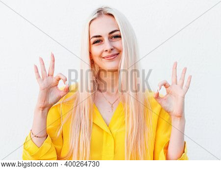 Cheerful Funny Cute Woman With Blonde Hair Gesturing Ok