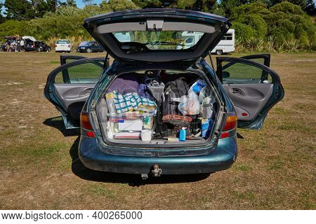 Car trunk ful of equipment for a camping road trip in New Zealand