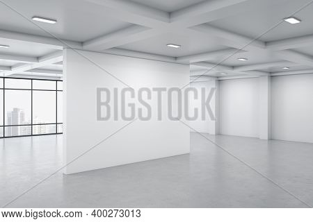Bright Concrete Gallery Interior With City View, Daylight And Blank Wall. Museum And Art Concept. Mo