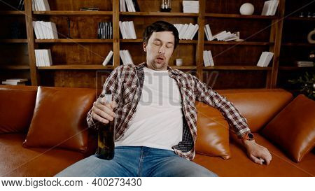 Alcohol Addiction At Young Age. Caucasian Male Cannot Stop Drinking Alcohol, Drunken Lonely Male Dri