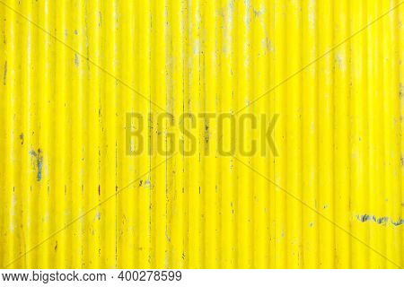 Scratched old zinc surface, yellow-painted steel wall surface, zinc with rust background, close to the patterned surface, vintage galvanized sheet, old yellow iron wall.