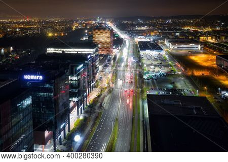 Gdansk, Poland - 18 December, 2020: Aerial cityscape of Gdansk Oliwia with modern office buildings at night, Poland.