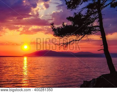 Sea sunset. Sunrise or sunset on ocean. Sunbeams at sunset. Happy summertime scene. Vacation and tourism.