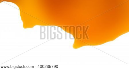 Sweet Caramel Sauce Topping Isolated On A White Background. Flowing Caramel