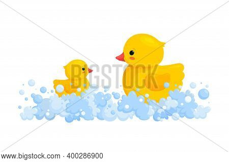 Rubber Duck Family In Soap Foam Isolated In White Background. Side View Of Yellow Plastic Duck Toys