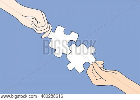 Teamwork, Cooperation, Partnership Concept. Hands Of People Making Whole Picture Of Puzzle Details T