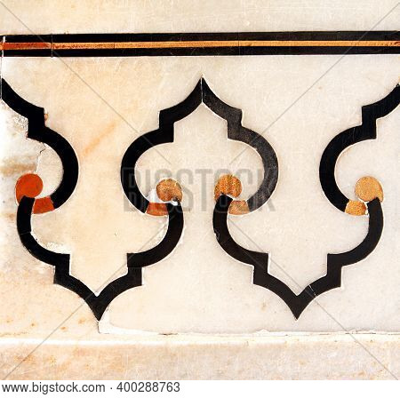 Detail of ancient marble geometrical ornament. Ancient mosaic on marble in Taj Mahal, India