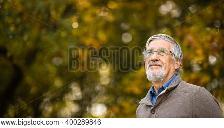 Portrait of a senior man outdoors, optimism, good health, happyness radiates of the man's face, expression