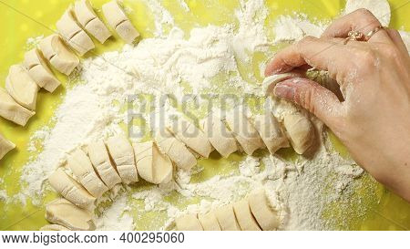 The Process Of Cooking Dumplings. The Process Of Preparing Dough For Dumplings, Rolling Out The Doug