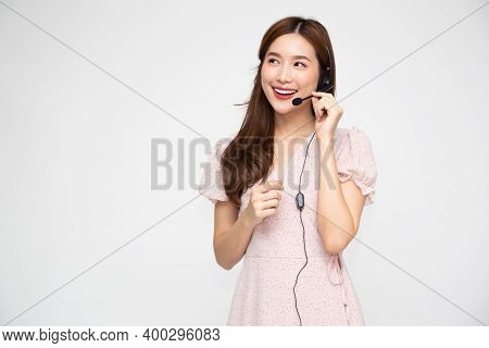 Young Asian Woman Call Center Isolated Over White Background, Telemarketing Sales Or Customer Servic