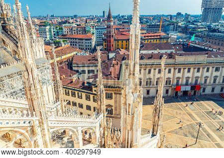 Top View From Roof Of Famous Duomo Di Milano Cathedral Of White Marble Statues And Royal Palace Pala