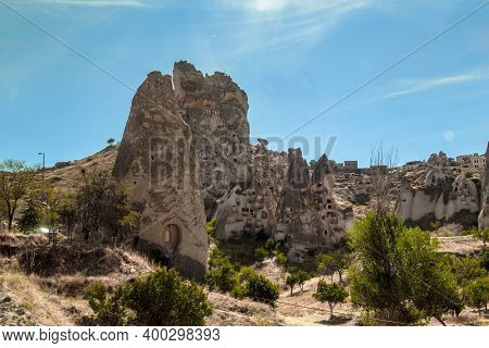Uchisar, Turkey - October 4, 2020: This Is One Of An Ancient Multistorey Houses Carved Into The Eros