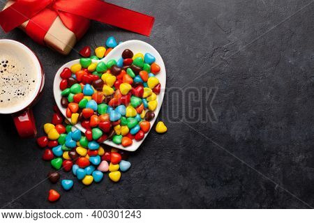 Heart shaped candies, coffee and gift box. Valentines day card. Top view flat lay with space for your greetings