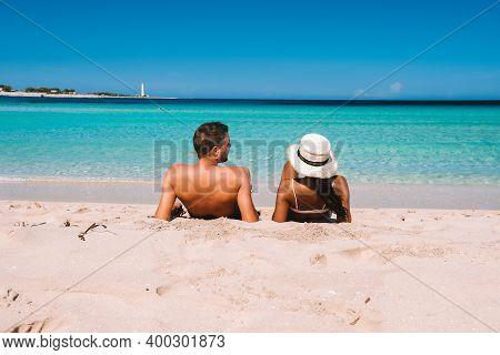 San Vito Lo Capo Sicilia, Couple Men And Woman Mid-age Visiting The Beach Of San Vito Lo Capo Sicily