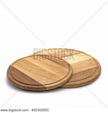 Set Of Kitchen Cutting Boards. Two Round Boards Of Different Sizes Are Made Of Natural Wood. There I