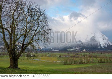 Winter Landscape With Snow Covered Grimming Mountain In Ennstal, Steiermark, Austria