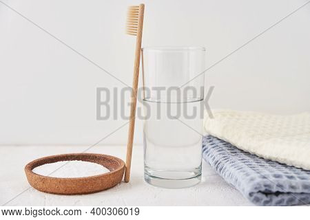Bamboo Toothbrush, Baking Soda And Glass Of Water On A White Background. Eco Friendly Toothbrushes,