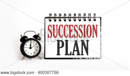 Succession Plan Notepad Writing On The White Background With Alarm Clock