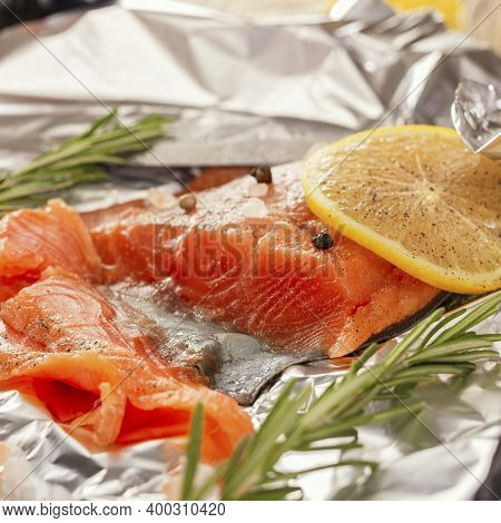 Salted Red Fish In Sliced, The Cooking Process In Foil. Natural Product, Dietary Food. Healthy Food.