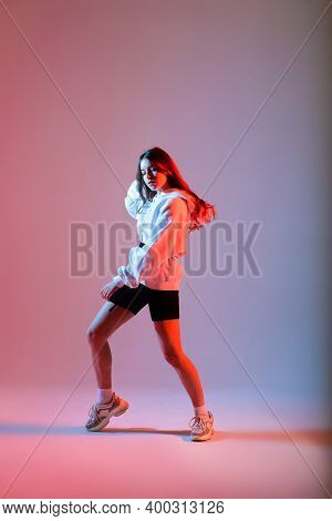 Teenage Female Dancing Hip-hop In Studio, Casual Clothes